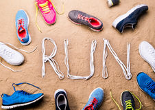 Free Running Shoes And Run Sign Made Of Shoelaces, Sand Royalty Free Stock Photo - 74484865
