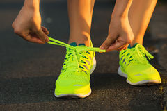 Running shoes. Barefoot running shoes closeup. Female athlete ty Stock Photos