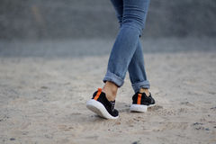 Running. A running shoes with beautiful jeans Stock Photo