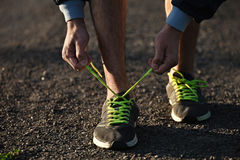 Running shoes being tied by man getting ready for jogging. Stock Photo