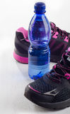 Running shoes and bottle of water - healthy lifestyle Stock Images