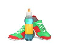 Running shoes with bottle Stock Image