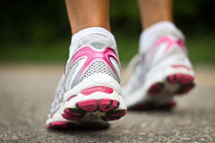 Running shoes close-up.  Female runner. Royalty Free Stock Photography