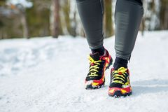 Running shoes - closeup of female sport fitness runner getting ready for jogging outdoors in winter.  Stock Image