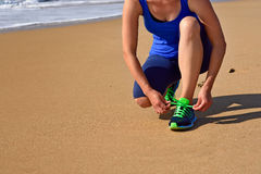 Running shoes closeup woman tying shoe laces Stock Photo