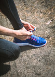 Running shoes. Closeup of woman tying shoe laces. Female sport f Royalty Free Stock Image