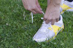 Running shoes - closeup of woman tying shoe laces. royalty free stock image