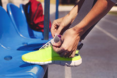 Running shoes. Closeup of woman tying shoe laces. Royalty Free Stock Photos