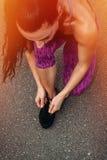 Running shoes - closeup of woman tying shoe laces stock photos