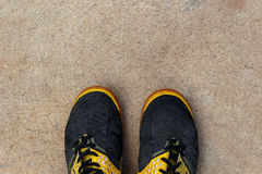 Running shoes on empty cement floor. Top view, running shoes on empty cement floor Royalty Free Stock Image