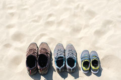 Running shoes family, the top view of the sand, vacation and holidays.  Royalty Free Stock Photos