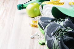 Running shoes and fitness equipment stock photography