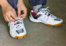 Running Shoes. The Girl Tying Running Shoes Royalty Free Stock Photo