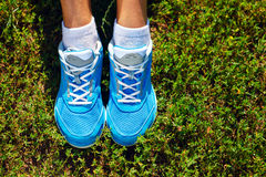 Running shoes on grass - concept Stock Images