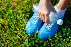 Running shoes on grass - concept Stock Photos