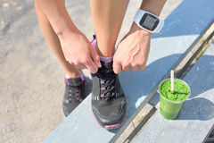 Running shoes green smoothie and sports smartwatch Royalty Free Stock Photo