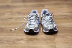Running shoes on a gym floor after workout Royalty Free Stock Photography