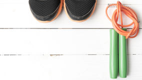 Running shoes and jumping rope Stock Photography