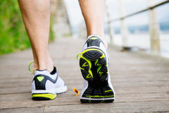 Running shoes. Legs and shoes of a running man. Back viiew Stock Image