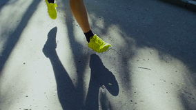 Running Shoes of Man Jogging Outdoors on Road. stock footage