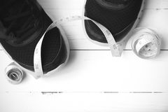 Running shoes and measuring tape black and white tone color styl Stock Photography