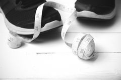Running shoes and measuring tape black and white tone color styl Stock Photo