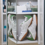 Running shoes in medicine cabinet Stock Photography