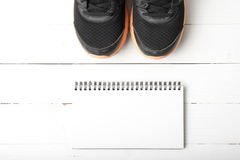 Running shoes and notepad stock photography