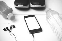 Running shoes,orange juice,drinking water and phone black and wh Royalty Free Stock Photography