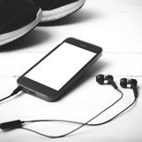 Running shoes and phone black and white tone color style Royalty Free Stock Photos