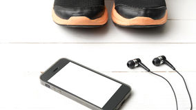 Running shoes and phone Royalty Free Stock Image