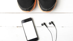 Running shoes and phone Stock Image