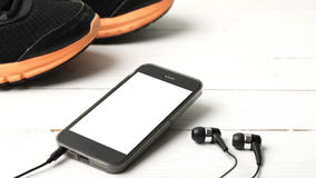 Running shoes and phone Stock Photo