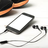 Running shoes and phone Royalty Free Stock Images
