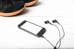Running shoes and phone Royalty Free Stock Photos