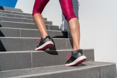 Running shoes runner woman walking up stairs royalty free stock images