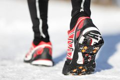 Running shoes in snow Royalty Free Stock Photo
