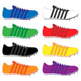 Running Shoes with Spikes and Stripes in Different Colours Stock Photo