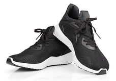 Running shoes or sport sneakers isolated on white. Pair of new unbranded black sport running shoes or sneakers isolated on white background with clipping path stock photography