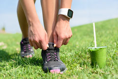 Running shoes sports smartwatch and green smoothie Royalty Free Stock Images