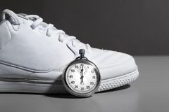 Running Shoes and stopwatch Stock Photography