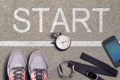 Running shoes and stopwatch. Hart rate monitor and watch whit pulse. Ready to run. Running on asphalt. Royalty Free Stock Photography