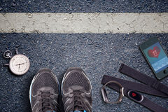 Running shoes and stopwatch. Hart rate sensor and watch whit pulse. Royalty Free Stock Images
