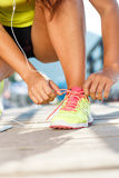 Running shoes - woman tying shoe laces. Closeup of female sport Royalty Free Stock Photo