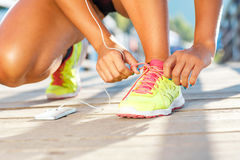 Running shoes - woman tying shoe laces Royalty Free Stock Photography