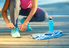 Running shoes - woman tying shoe laces Stock Photography