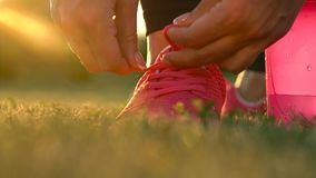 Running shoes - woman tying shoe laces stock footage