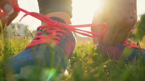 Running shoes - woman tying shoe laces. Slow motion stock footage