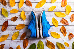 Running shoes on wooden floor Stock Photo
