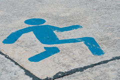 Running sign on concrete road Royalty Free Stock Images